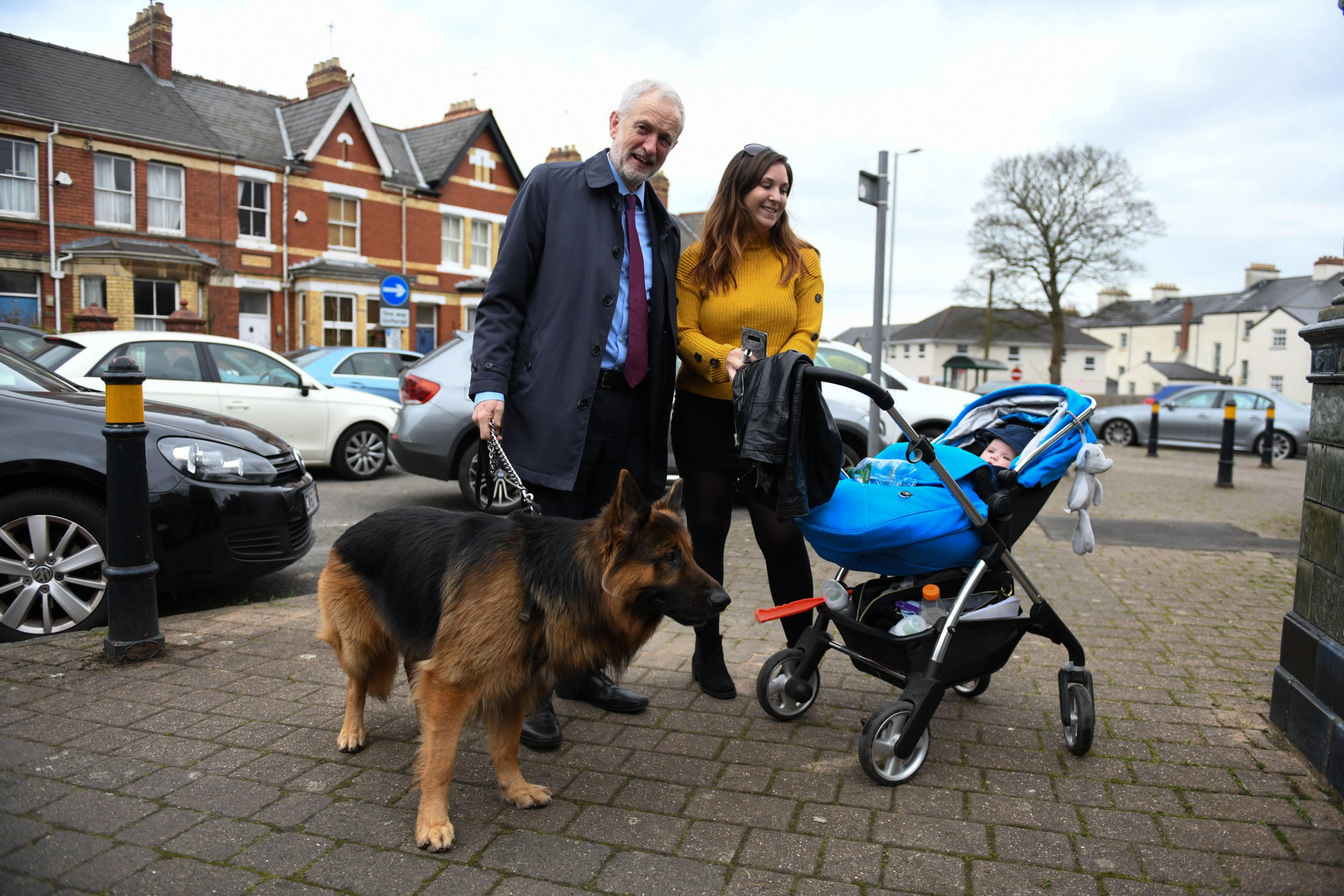 Alamy Live News. T0YCPK Newport, South Wales, UK. 22nd March 2019 Pictured is Jeremy Corbyn with an alsatian dog called Acer, at he meets members of the public after attending attending the funeral of Newport MP Paul Flynn at St Woolos Cathedral, Stow Hill, Newport, Wales. Credit : Robert Melen/Alamy Live News. This is an Alamy Live News image and may not be part of your current Alamy deal . If you are unsure, please contact our sales team to check.