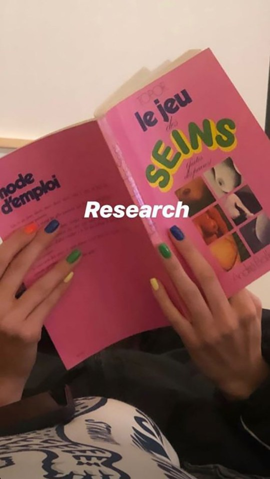 Kendall Jenner studies up on book of breasts and you can never have too much education