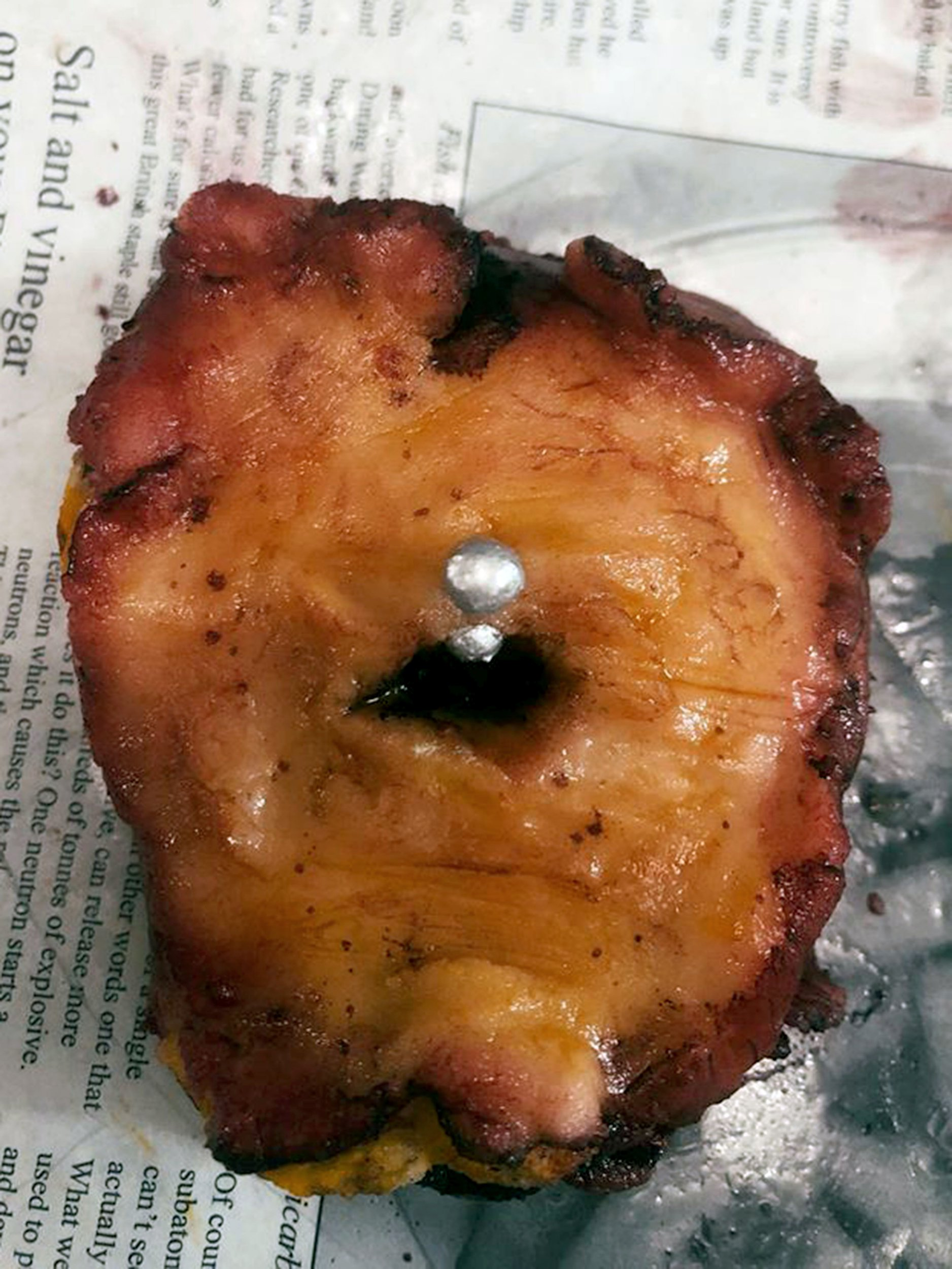 PIC FROM Caters News- (PICTURED: Tanya Nisa, 42, from Lincoln creates gory cakes that resemble human flesh. Pictured is a belly button) - A young mum-of-four has been branded a CANNIBAL online for creating cakes that resemble human flesh. From severed fingers, feet and arms, Tanya Nisa, 42, has spent the past seven years perfecting her craft of gory cakes after becoming inspired by the film, Hannibal.Yet the realistic cakes seeping fake blood and profiling severed limbs and lifelike faces have scared more than a few online as Tanya, an interior designer, has been forced to explain that her creations are actually freshly Victoria sponge cakes.SEE CATERS COPY