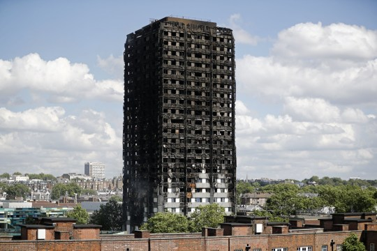 TOPSHOT - The remains of residential tower block Grenfell Tower are pictured, in west London on June 15, 2017, a day after it was gutted by fire. Firefighters searched for bodies today in a London tower block gutted by a blaze that has already left 12 dead, as questions grew over whether a recent refurbishment contributed to the fire. / AFP PHOTO / Tolga AKMEN (Photo credit should read TOLGA AKMEN/AFP/Getty Images)
