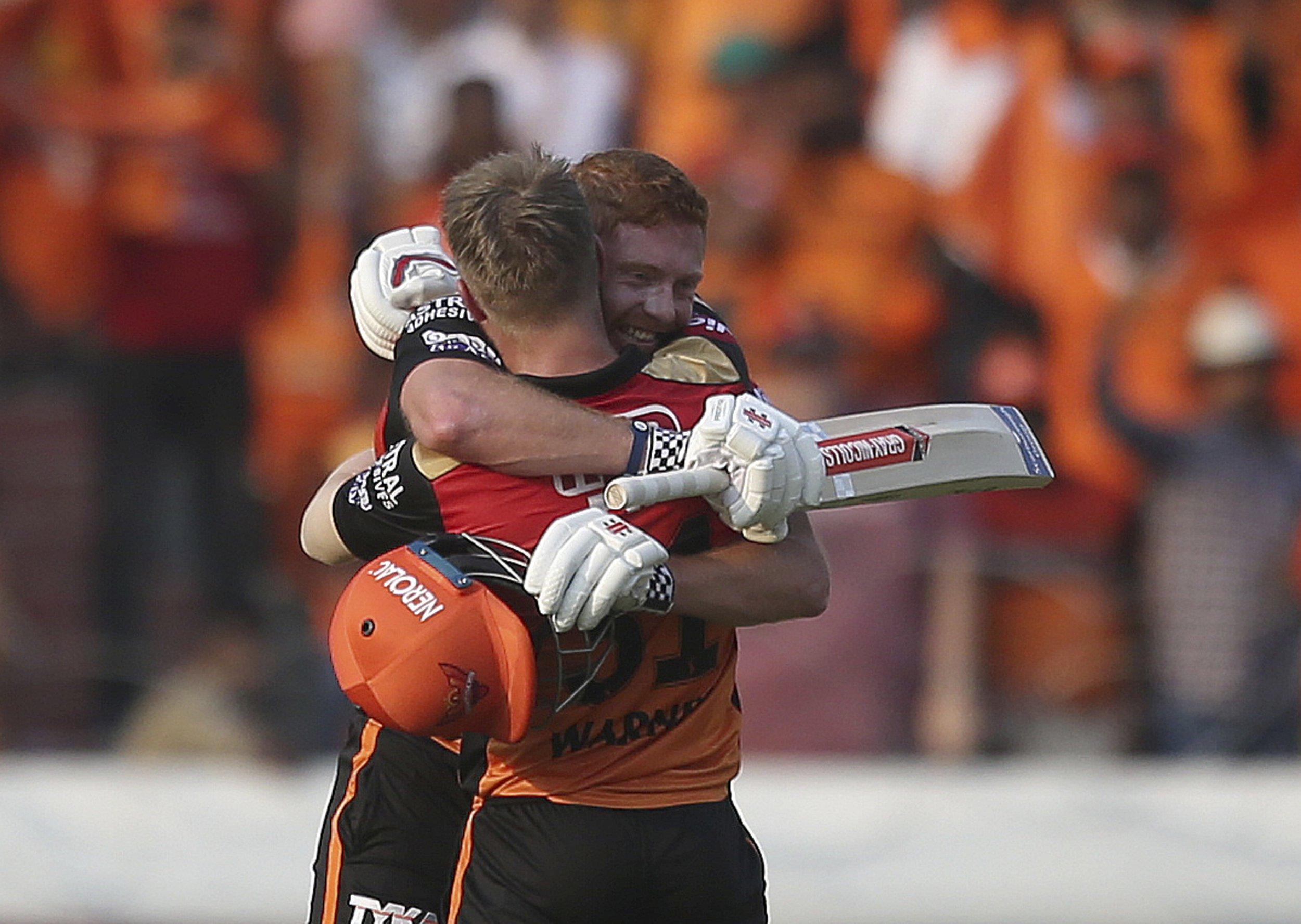 Sunrisers Hyderabad's David Warner hugs Jonny Bairstow on scoring hundred runs against Royal Challengers Bangalore during the VIVO IPL T20 cricket match in Hyderabad, India, Sunday, March 31, 2019. (AP Photo/ Mahesh Kumar A.)