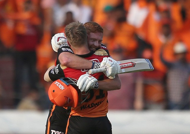 Sunrisers Hyderabad's David Warner hugs Jonny Bairstow on scoring hundred runs against Royal Challengers Bangalore during the VIVO IPL T20 cricket match in Hyderabad, India, Sunday, March 31, 2019. (AP Photo/ Mahesh Kumar A.)