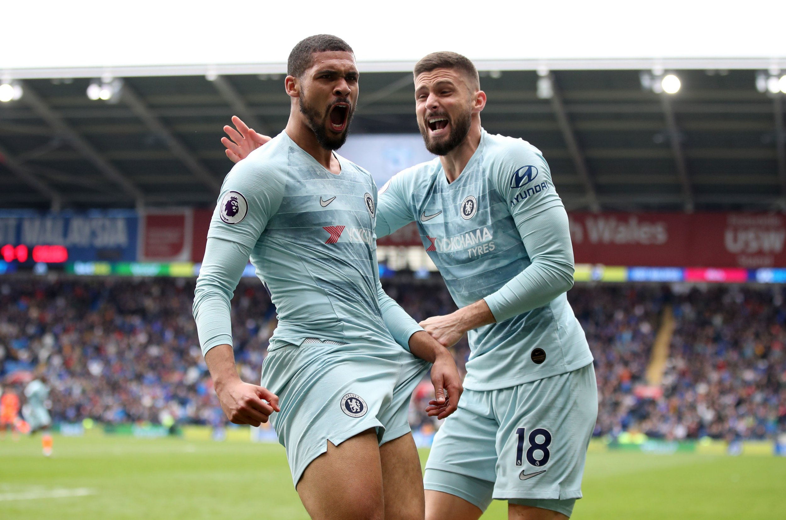 """Chelsea's Ruben Loftus-Cheek (left) celebrates scoring his side's second goal of the game during the Premier League match at the Cardiff City Stadium, Cardiff. PRESS ASSOCIATION Photo. Picture date: Sunday March 31, 2019. See PA story SOCCER Cardiff. Photo credit should read: Nick Potts/PA Wire. RESTRICTIONS: EDITORIAL USE ONLY No use with unauthorised audio, video, data, fixture lists, club/league logos or """"live"""" services. Online in-match use limited to 120 images, no video emulation. No use in betting, games or single club/league/player publications."""