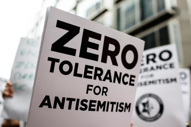 A placard reads 'zero tolerance for antisemitism'