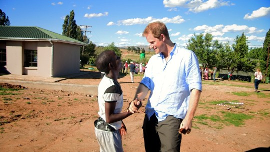 Television programme, 'Prince Harry In Africa', TX ITV 19th December 2016. Screen grab shows : The moment that Prince Harry is reunited with Mutsu aged 15yrs ,in November 2015 Mutsu is a local teenager who the Prince met on his first visit to Lesotho, and with whom he has since remained in regular contact This brand new film for ITV follows HRH Prince Harry on his return to Lesotho, in Africa, to continue the work of Sentebale, the charity he set up in the country a decade ago. Prince Harry first travelled to the little known kingdom of Lesotho 12-years ago, shadowed by broadcaster Tom Bradby. It was there, after seeing the country's disadvantaged children, that the Prince decided to follow in the humanitarian footsteps of his mother, Diana, Princess of Wales, and set up Sentebale (translated as Forget Me Not), which provides care, support and education to youth affected by HIV and AIDS in Lesotho and Botswana. This film will see Prince Harry set off on an unforgettable adventure, where cameras will bear witness to his travels through the beautiful and challenging scenery to remote locations with his deeply personal aim of discovering the stories that he wants to tell to the world. The film will also capture the moment that Prince Harry is reunited with Mutsu, a local teenager who the Prince met on his first visit to Lesotho, and with whom he has since remained in regular contact, both knowing firsthand what is was like growing up without a parent. Featuring footage of Prince Harry getting his hands dirty helping out with the charity's work on the ground and interacting with the local children, the film will discover how the Prince has come to have such an understanding of their problems and how this led him to set up his own initiative, with the aim of supporting orphans and vulnerable children and helping them through education. Also, in an interview with Bradby, the Prince will reveal his motives for setting up the charity, his passion for the future of his work in Africa, and how he's determined to use his unique position to do good. ? Big Earth Productions Photographer Chris Jackson For further information please contact Peter Gray 0207 157 3046 peter.gray@itv.com This photograph is ? Big Earth Productions and can only be reproduced for editorial purposes directly in connection with the programme PRINCE HARRY IN AFRICA or ITV. Once made available by the ITV Picture Desk, this photograph can be reproduced once only up until the Transmission date and no reproduction fee will be charged. Any subsequent usage may incur a fee. This photograph must not be syndicated to any other publication or website, or permanently archived, without the express written permission of ITV Picture Desk. Full Terms and conditions are available on the website www.itvpictures.com From Big Earth Productions