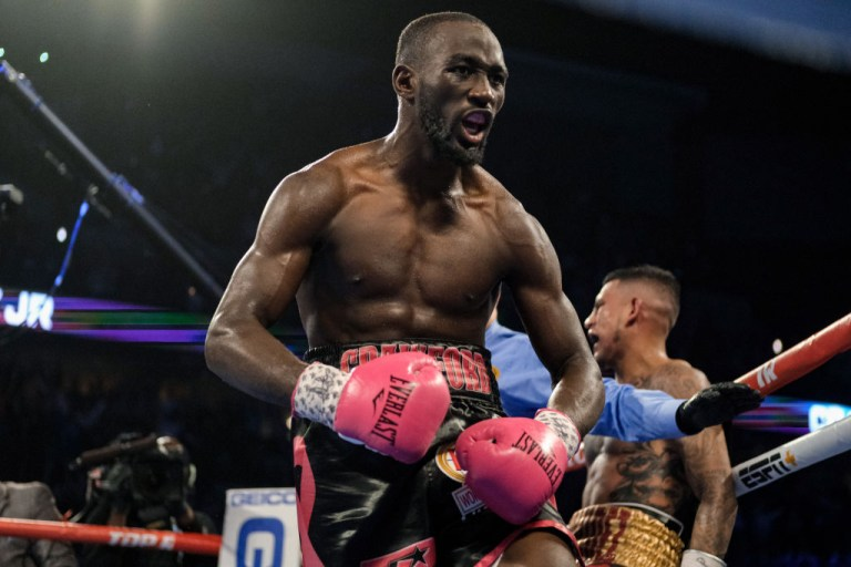 Terence Crawford celebrates a stoppage victory