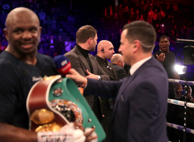 Anthony Joshua talks to Dillian Whyte from ringside