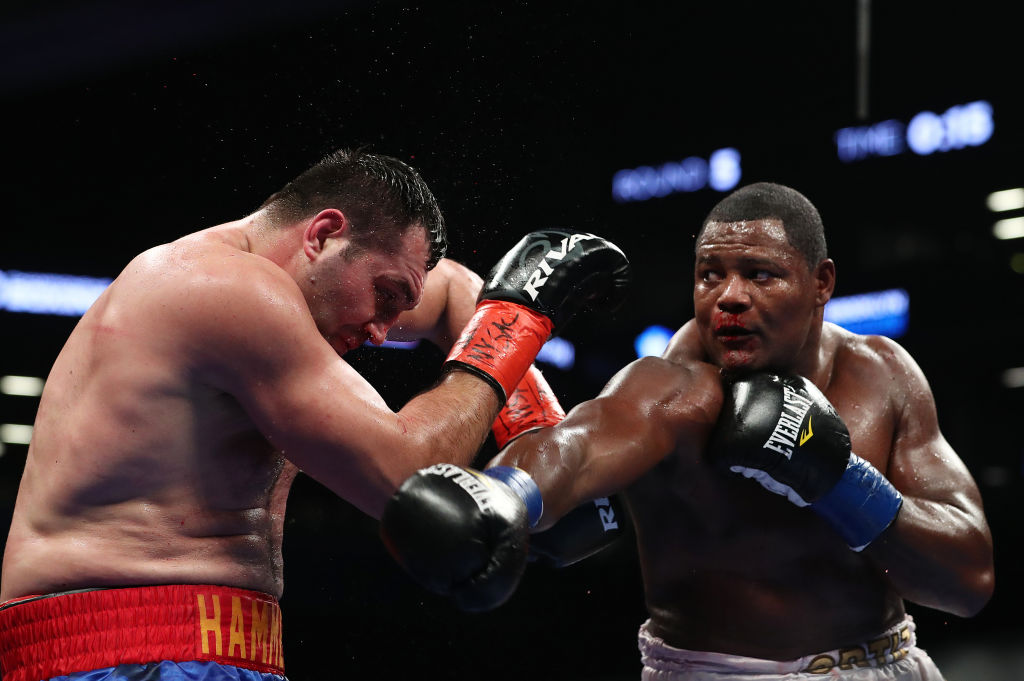 Luis Ortiz punches Christian Hammer