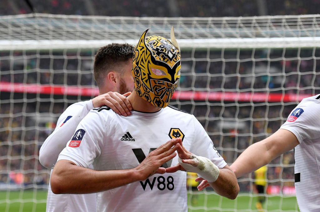 Raul Jimenez celebrates with Sin Cara's mask during Wolves' FA Cup semi-final against Watford