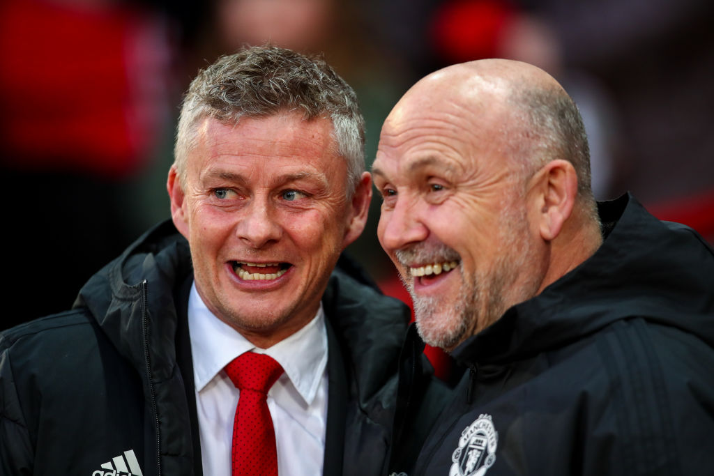 Ole Gunnar Solskjaer and Mike Phelan laugh on the touchline