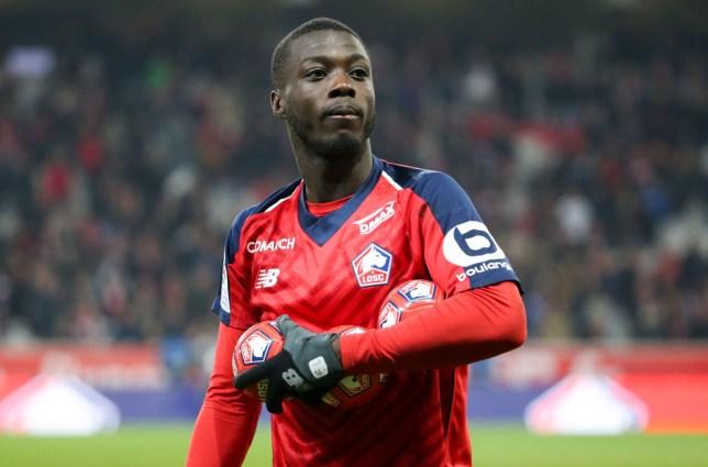 Nicolas Pépé celebrates after beating PSG