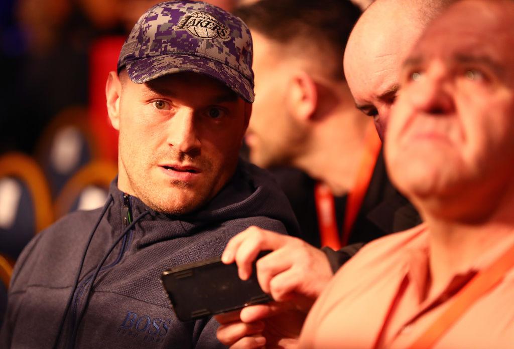 Tyson Fury looks on from ringside