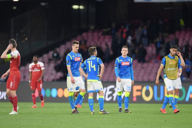 Napoli stars look on dejected during game against Arsenal