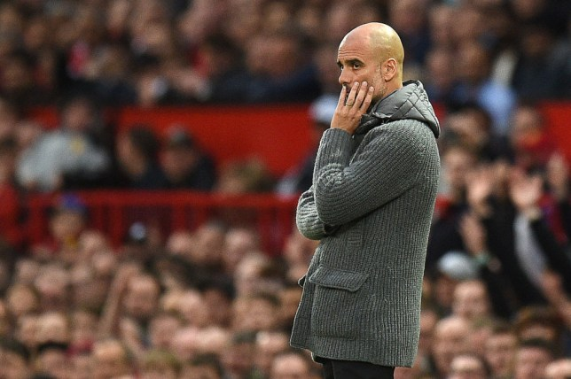 Pep Guardiola looks on from the touchline