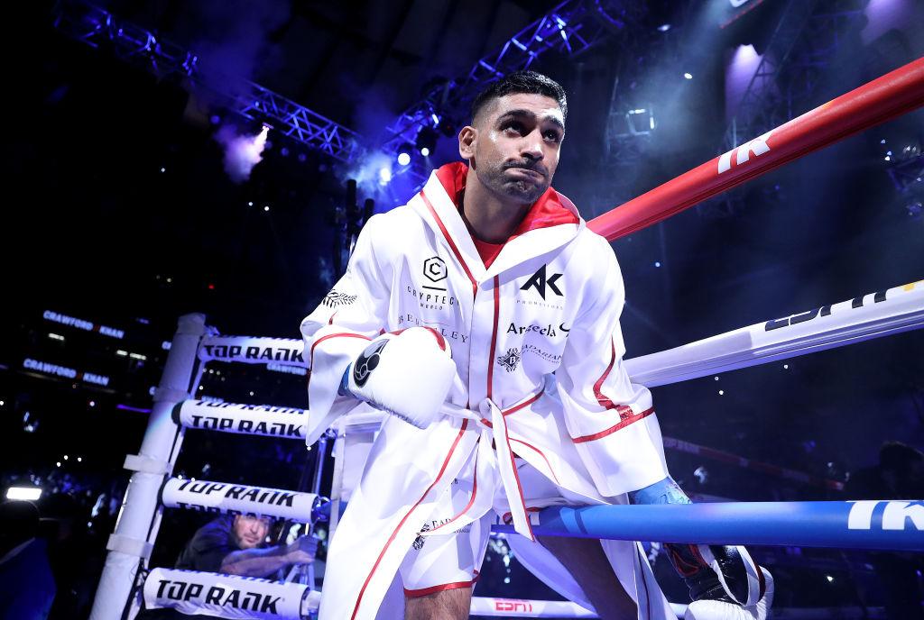 Amir Khan steps through the ropes