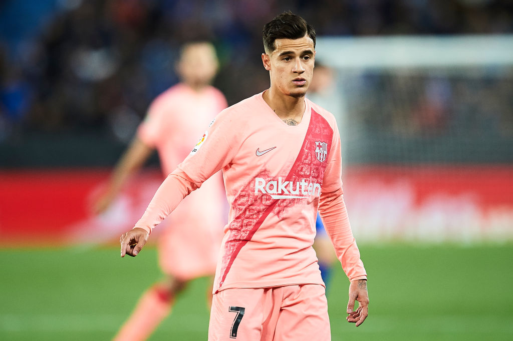 Philippe Coutinho points during a game