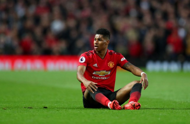 Rashford sitting on the pitch