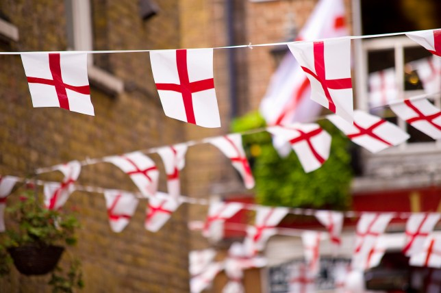 Flags with St George's Cross on them hanging on a street in London to celebrate St George's Day