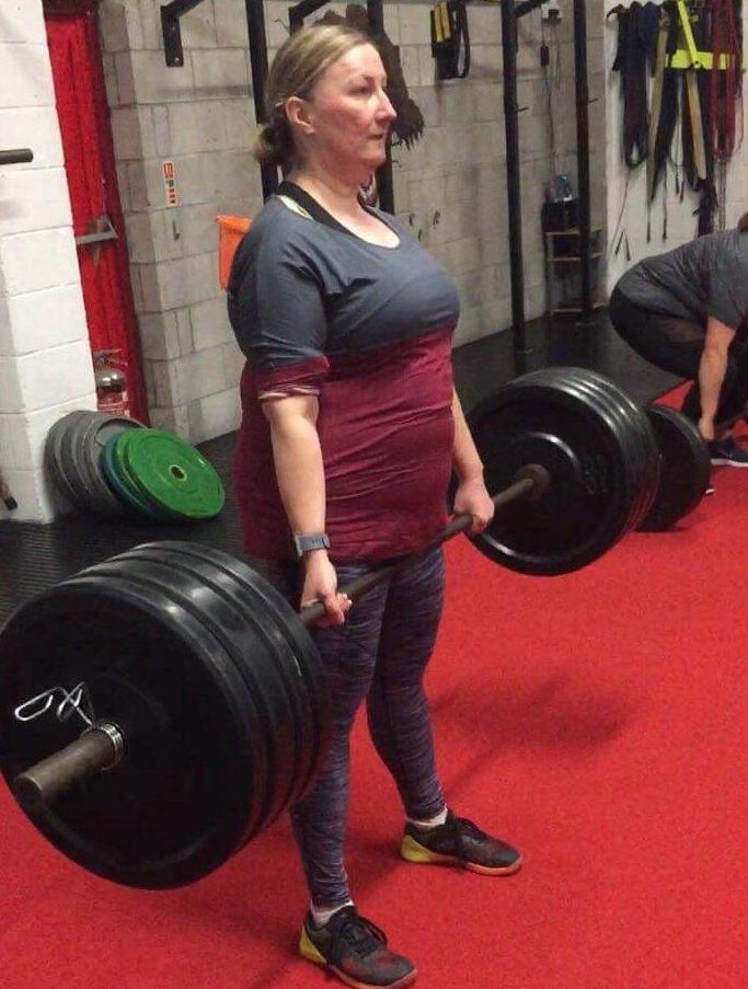 Finn Madell lifting weights