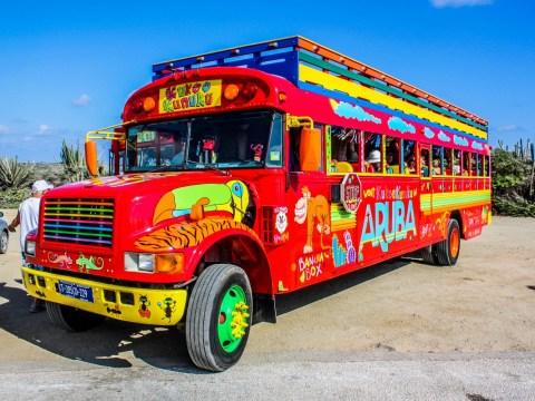 Explore Aruba on the island's Kukoo Kunuku party bus