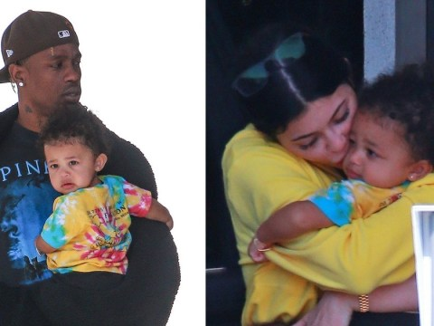 Kylie Jenner and Travis Scott smother baby Stormi with kisses while arriving back from family holiday