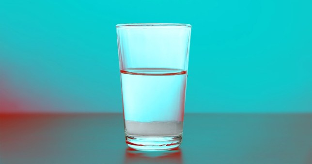A glass of water sits on a table as we wonder how much water is too much