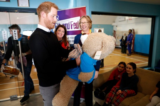 The Duke of Sussex is given the gift of a large teddy during a visit to Streatham Youth and Community Trust's John Corfield Centre to see a 'Fit and Fed' February half-term holiday activity programme. PRESS ASSOCIATION Photo. Picture date: Tuesday February 19, 2019. Photo credit should read: Chris Jackson/PA Wire