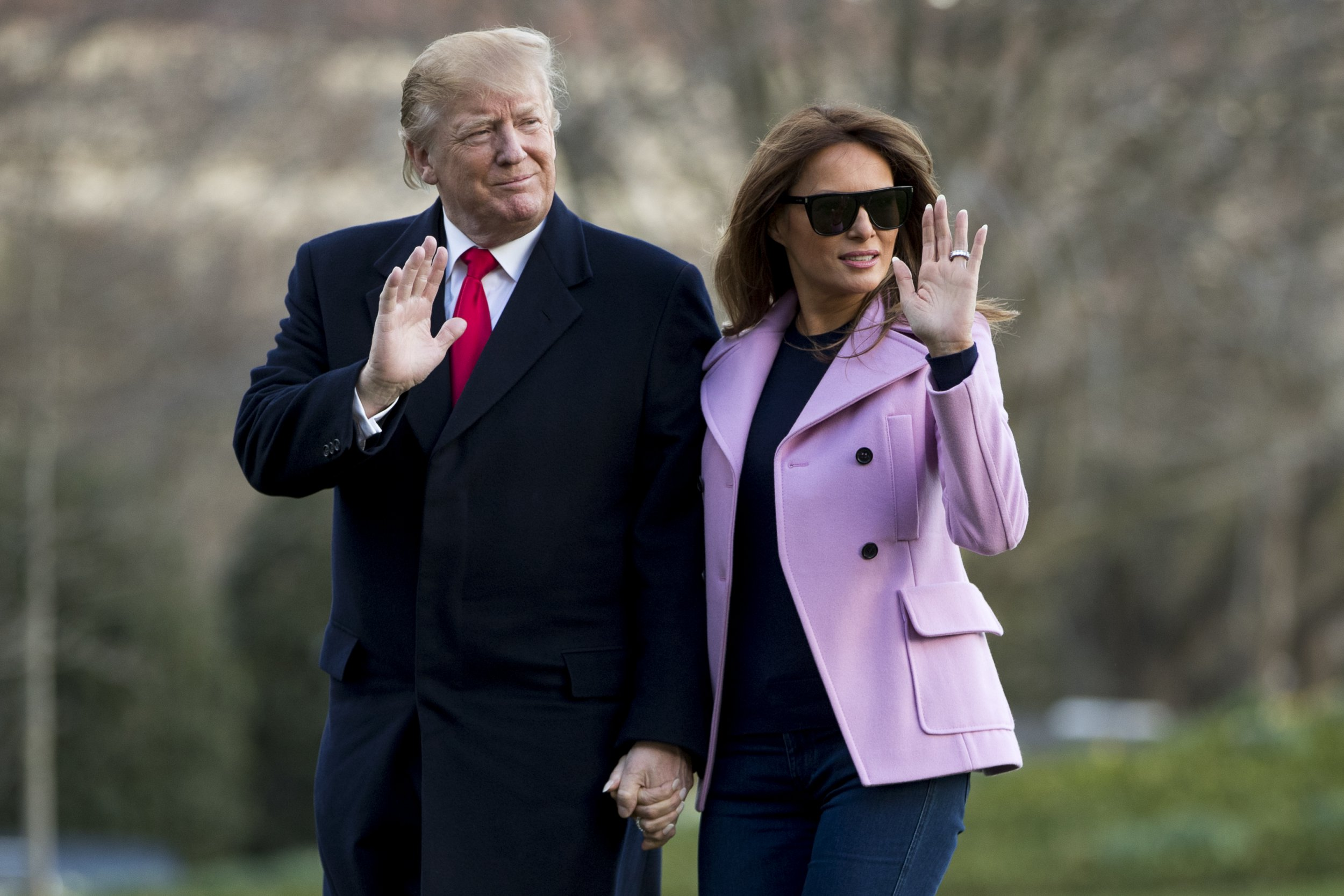 President Donald Trump and first lady Melania Trump walk along the South Lawn of the White House in Washington, Sunday, March 31, 2019, as they return from Trump's Mar-a-lago estate in Palm Beach, Fla. (AP Photo/Andrew Harnik)