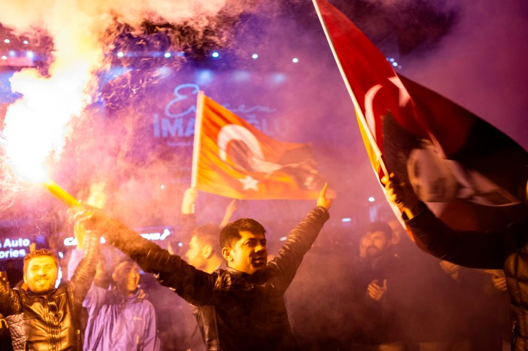 TOPSHOT - Supporters of the main opposition Republican People's Party (CHP) wave flags and light up torches to celebrate the local election in Istanbul, Turkey on 1 April 2019. (Photo by Yasin AKGUL / AFP)YASIN AKGUL/AFP/Getty Images