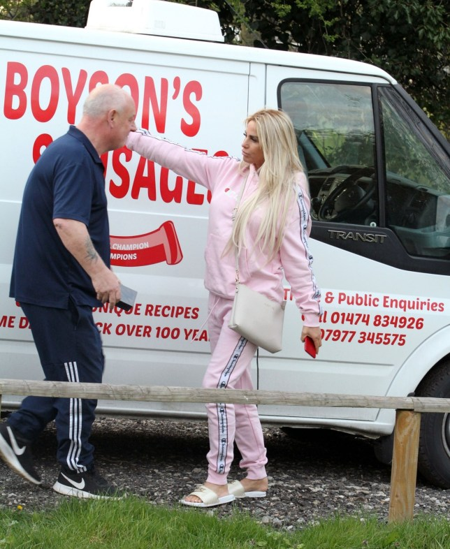 BGUK_1535259 - *EXCLUSIVE* London, UNITED KINGDOM - WEB MUST CALL FOR PRICING - Katie Price aka Jordan looks 'Pretty In Pink' in her tracksuit on a visit to boyfriend's Kris Boyson's family business. A delighted Katie met up with daughter Princess as she rocked up in her trademark infamous pink Range Rover driven by Kris to whom Katie is still serving a driving ban. The gang met Kris's father who runs the family trade entitled 'Boyson's Sausages' as Katie gave him a hug. It was all a little surreal for the glamour model as she draped on the sausage van laughing hysterically. *PICTURES TAKEN ON 01/04.2019* Pictured: Katie Price - Jordan BACKGRID UK 3 APRIL 2019 UK: +44 208 344 2007 / uksales@backgrid.com USA: +1 310 798 9111 / usasales@backgrid.com *UK Clients - Pictures Containing Children Please Pixelate Face Prior To Publication*