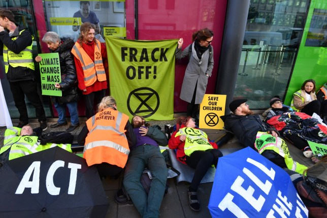 Activists from Extinction Rebellion stage an anti-fracking protest outside the Department for Business, Energy and Industrial Strategy in Westminster, London.