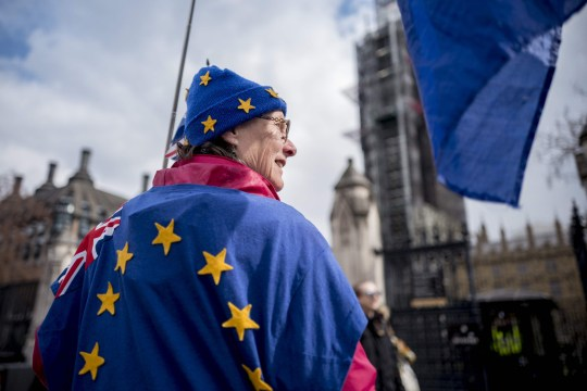 A pro-EU campaigener wears EU colours as she demonstrates near the Houses of Parliament in central London on April 3, 2019. - Prime Minister Theresa May was to meet on Wednesday with the leader of Britain's main opposition party in a bid to thrash out a Brexit compromise with just days to go until the deadline for leaving the bloc. (Photo by Tolga Akmen / various sources / AFP)TOLGA AKMEN/AFP/Getty Images
