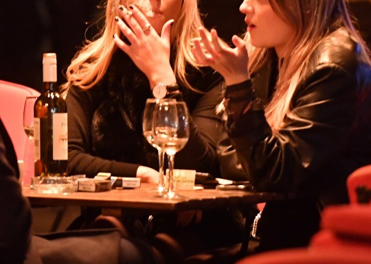 File photo dated 14/12/18 of women drinking white wine and smoking outside a bar in central London. Moderate alcohol use can contribute to a diet with better results for memory skills in middle age, research from Queen's University Belfast has showed. PRESS ASSOCIATION Photo. Issue date: Thursday April 4, 2019. The regime also emphasised eating fruit, pulses, vegetables, low-fat dairy and fish and avoiding common unhealthy food. See PA story ULSTER Alcohol. Photo credit should read: John Stillwell/PA Wire