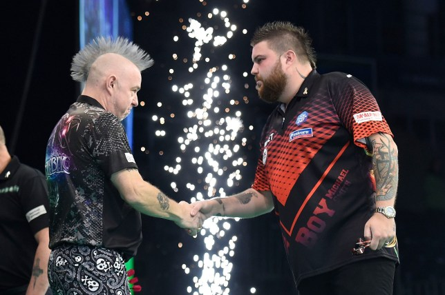 4/4/19: Michael Smith and Peter Wright during the Unibet Premier League Darts at the SSE Arena, Belfast. Picture: Michael Cooper