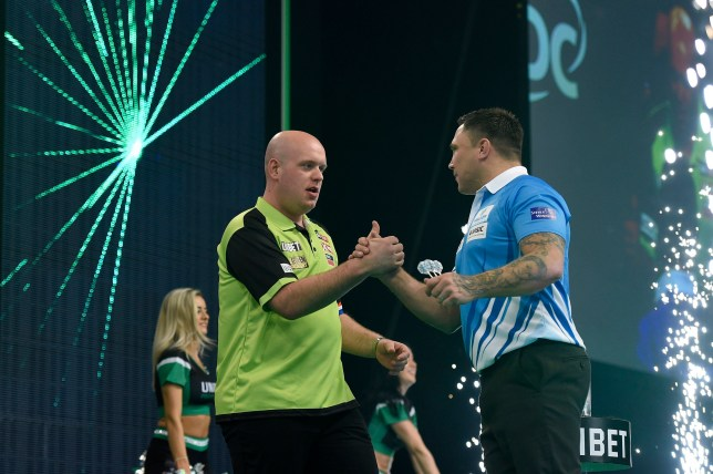4/4/19: Michael van Gerwen and Gerwyn Price during the Unibet Premier League Darts at the SSE Arena, Belfast. Picture: Michael Cooper