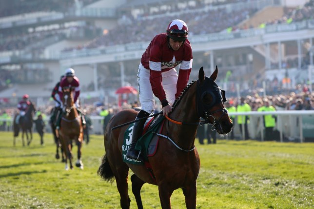 LIVERPOOL, ENGLAND - APRIL 06: Daryl Russell riding Tiger Roll makes his way to the start prior to the Randox Health Grand National Handicap Chase at Aintree Racecourse on April 06, 2019 in Liverpool, England. (Photo by Alex Livesey/Getty Images)