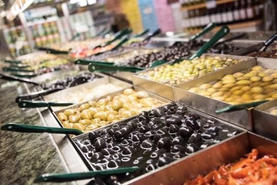 Assorted olives for sale in a supermarket