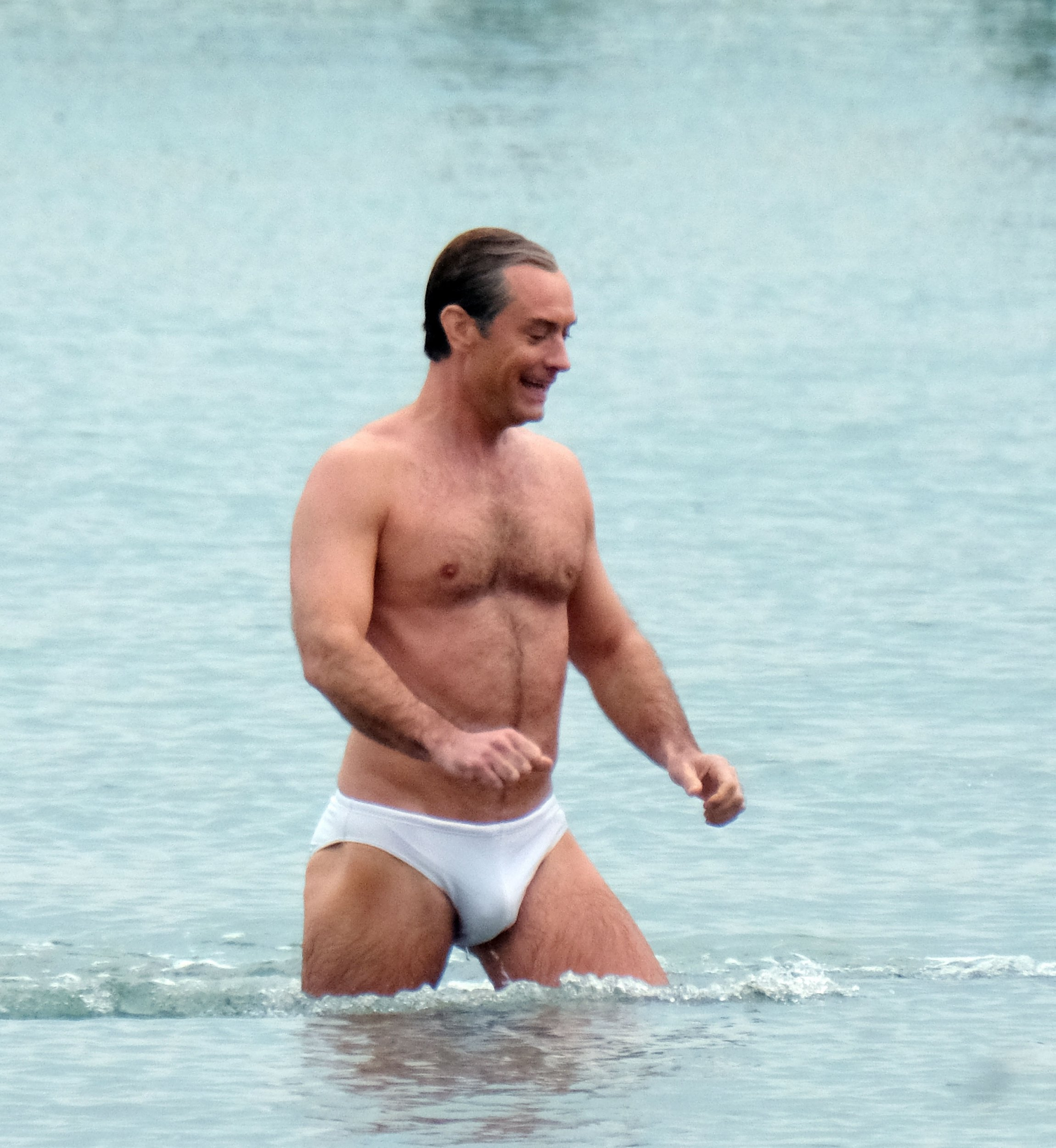 """BGUK_1543732 - ** RIGHTS: ONLY UNITED KINGDOM ** Venice, ITALY - British Actor Jude law shows off his toned Physique as he's pictured filming in his Y fronts Briefs while pictured filming TV series """"The new Pope"""" in Venice. Jude looked in Good spirits as he was seen laughing while leaving the sea with a crew member! Pictured: Jude law BACKGRID UK 9 APRIL 2019 BYLINE MUST READ: CIAOPIX / BACKGRID UK: +44 208 344 2007 / uksales@backgrid.com USA: +1 310 798 9111 / usasales@backgrid.com *UK Clients - Pictures Containing Children Please Pixelate Face Prior To Publication*"""