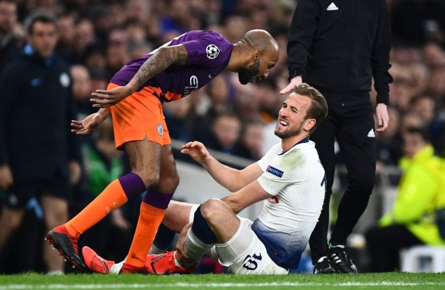 Editorial use only Mandatory Credit: Photo by Javier Garcia/BPI/REX (10195651ae) Harry Kane of Tottenham Hotspur is injured after a challenge from Fabian Delph of Manchester City Tottenham v Manchester City, UEFA Champions League Quarter Finals, First Leg Football, Tottenham Hotspur Stadium, London, UK - 09 Apr 2019