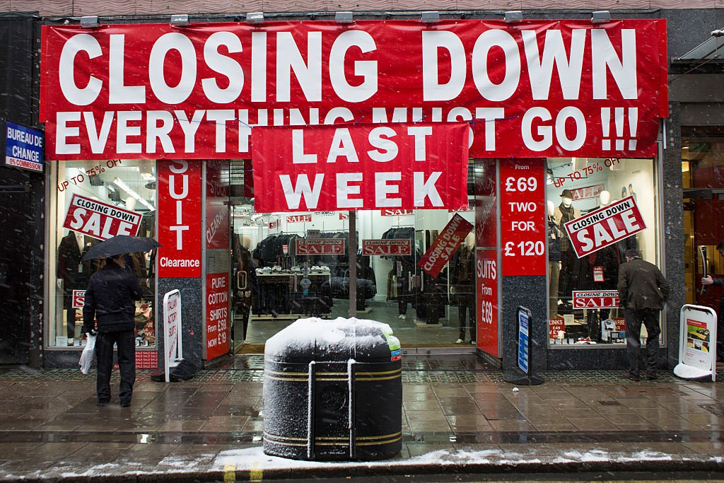A male clothing shop in the last week of a closing down sale on Oxford Street, London, United Kingdom. The recent recession has forced many shop closures, especially small and independent shops. (Photo by In Pictures Ltd./Corbis via Getty Images)