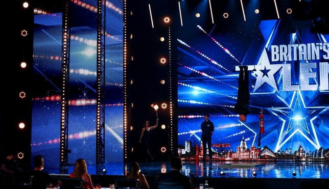 Jonathan Goodwin performs on Britain's Got Talent where he attempts to escape a burning strait jjacket