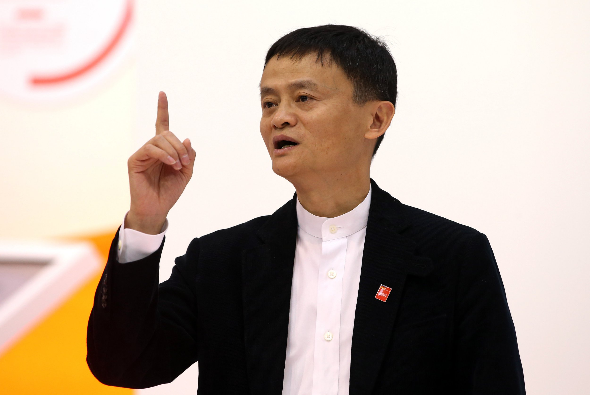 Jack Ma, founder and CEO of Chinese internet company Alibaba Group, stands at the exhibition stand of his company at the computer fair CeBIT in Hanover, Germany, 16 March 2015. The world's biggest computer fair CeBIT runs until 20 March 2015, partner country is China. PHOTO: CHRISTIAN??CHARISIUS/dpa