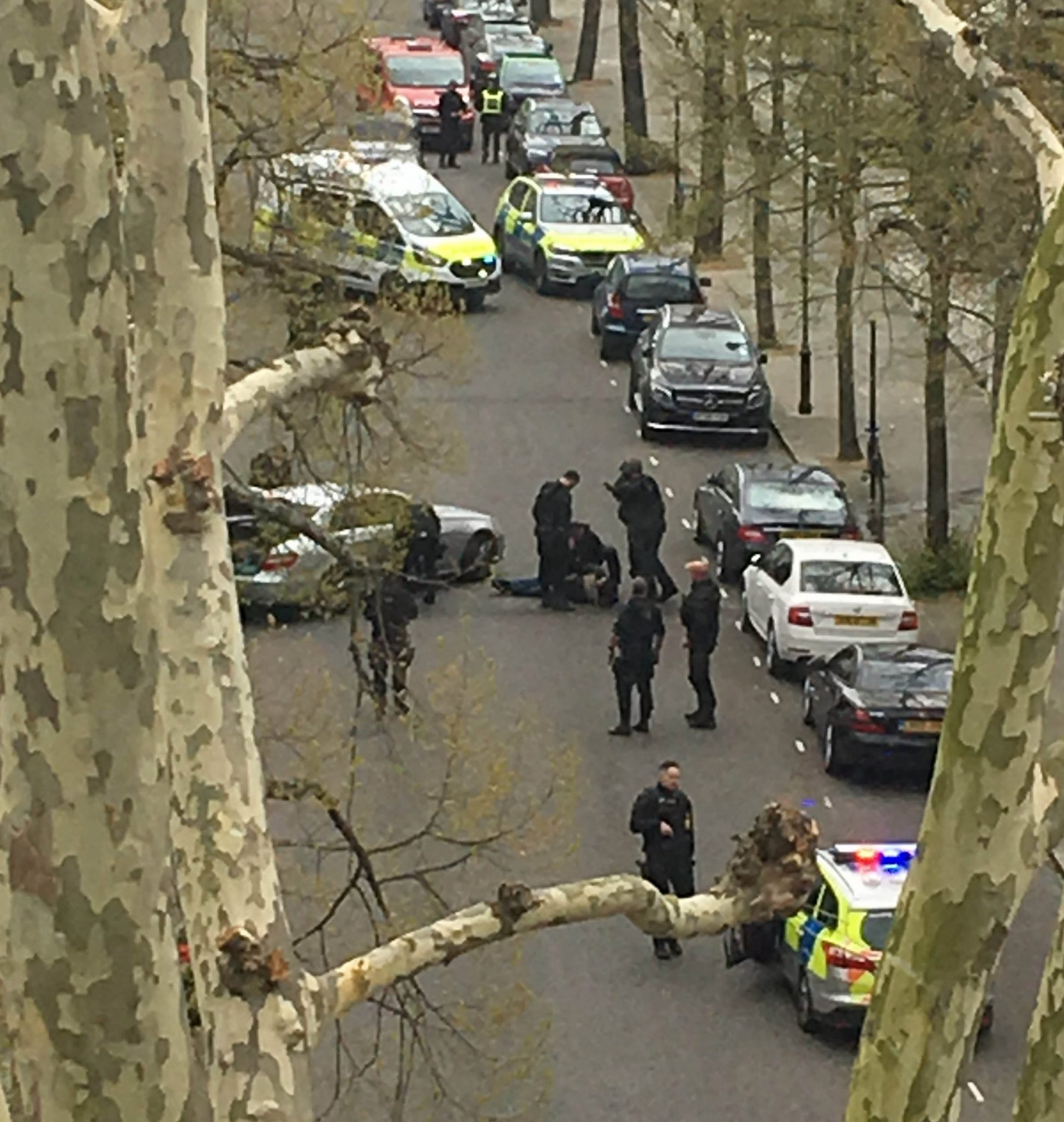 """Police apprehend a suspect near the Ukrainian Embassy in Holland Park, west London after police fired shots when the ambassador's car was """"deliberately rammed"""". PRESS ASSOCIATION Photo. Picture date: Saturday April 13, 2019. The embassy said the official car of the Ambassador of Ukraine to the UK, Natalia Galibarenko, was attacked on Saturday morning at around 10am. No one was injured in the incident and one person was taken to a police station. See PA story POLICE HollandPark. Photo credit should read: Emma Slatter/PA Wire NOTE TO EDITORS: This handout photo may only be used in for editorial reporting purposes for the contemporaneous illustration of events, things or the people in the image or facts mentioned in the caption. Reuse of the picture may require further permission from the copyright holder."""
