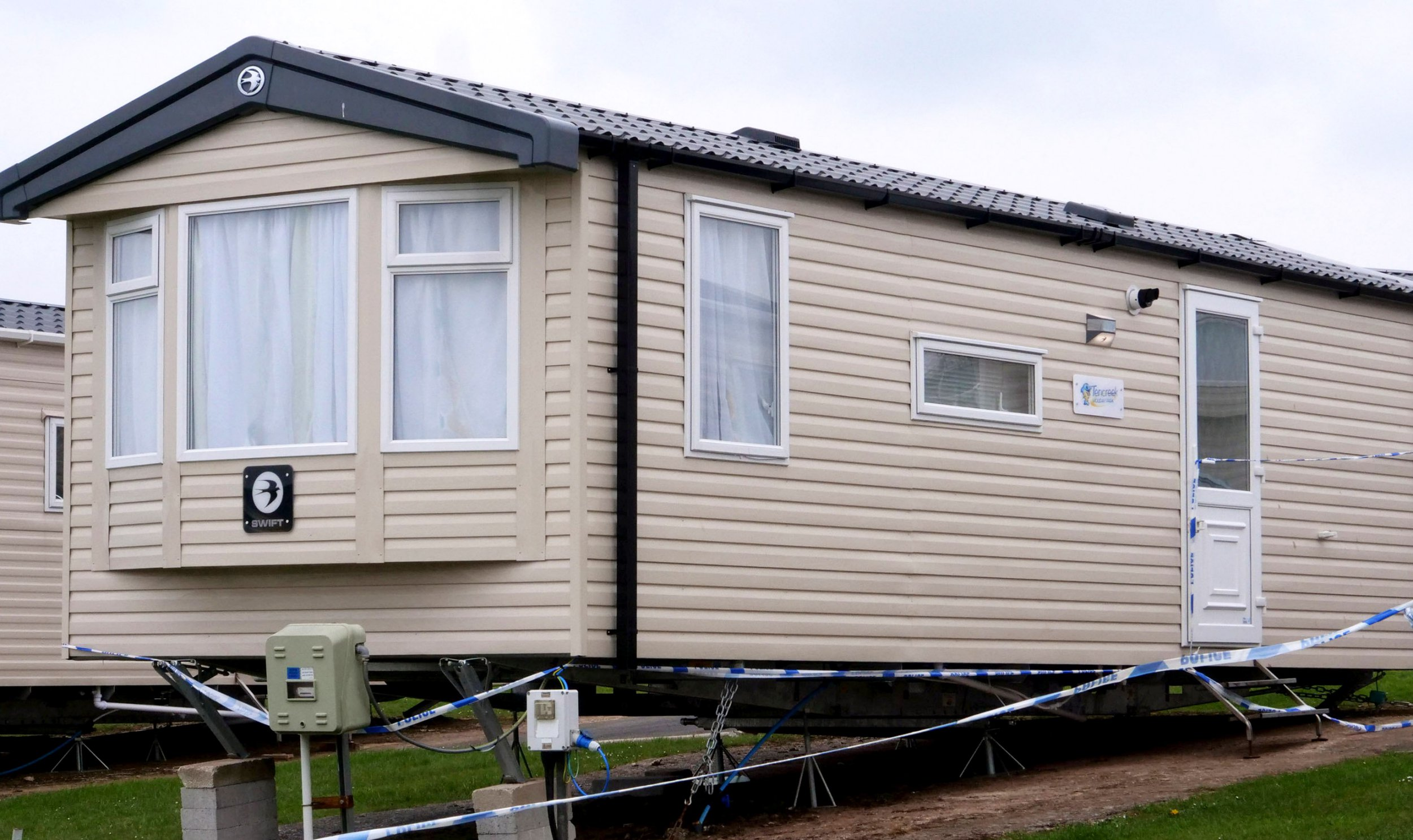 Police tapes cordon off a large area around static caravans at the Tencreek Holiday Park, Looe, Cornwall today, April 14, 2019, where a ten-yer-old boy was tragically killed by a large dog in the early hours of Saturday morning. See SWNS story SWPLdog. Police were called to a caravan at Tencreek Holiday Park in Looe just before 5am on Saturday (13/4) morning, following reports of a 10-year-old boy in an unresponsive state after being attacked by a dog, believed to be a bulldog-type breed. Emergency services attended but tragically the child was pronounced deceased at the scene. The boy?s next of kin are aware and are being supported by police officers. Following this incident, searches were undertaken to locate the dog and its owner. Police arrested a 28-year-old woman in Saltash just after 8am on the same morning in connection to this matter. The dog was also located which has since been transferred to kennels.