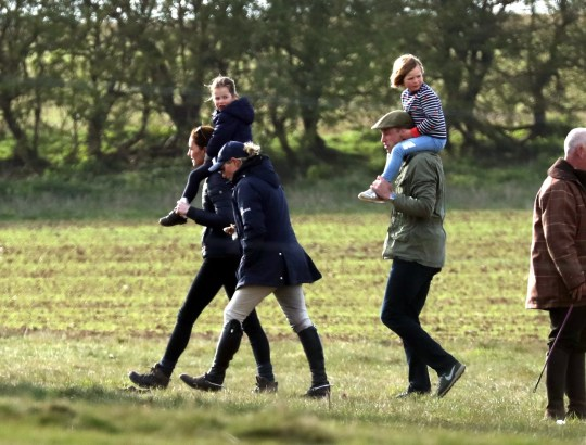 **DO NOT CREDIT** Kate (Duchess of Cambridge) carrying Charlotte, Zara Tindall, beside them and William (Duke of Cambridge) with Mia Tindall on his shoulders at the Burnham Horse Trials, Norfolk, UK, on April 12, 2019. **DO NOT CREDIT** **Minimum fee ?500.00, including online use**