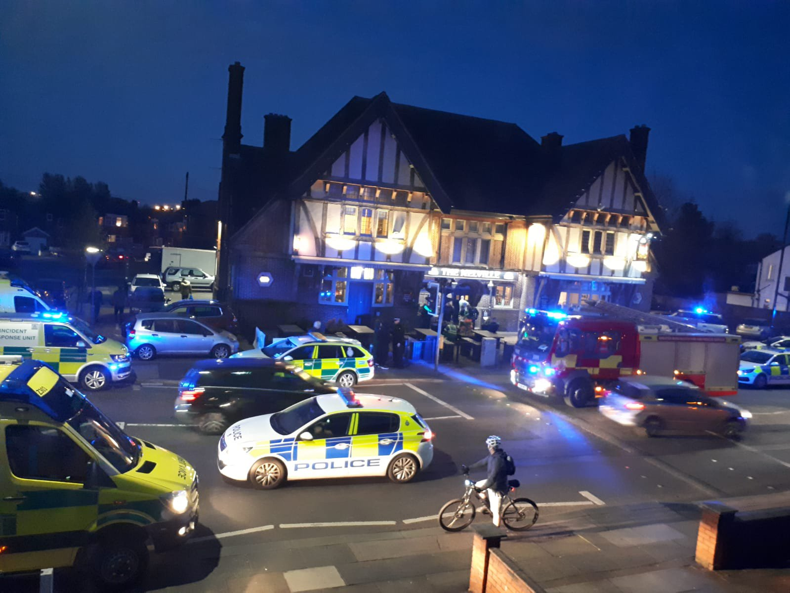A man is fighting for life after a violent melee in a pub - as three arrested men have been released under investigation by police. Cops were called to reports of a disturbance at The Melville in Stretford, Greater Manchester, on Friday night [April 12]. Caption: Emergency services outside The Melville pub in Stretford, Greater Manchester, where a man was critically injured in a disturbance on April 12, 2019