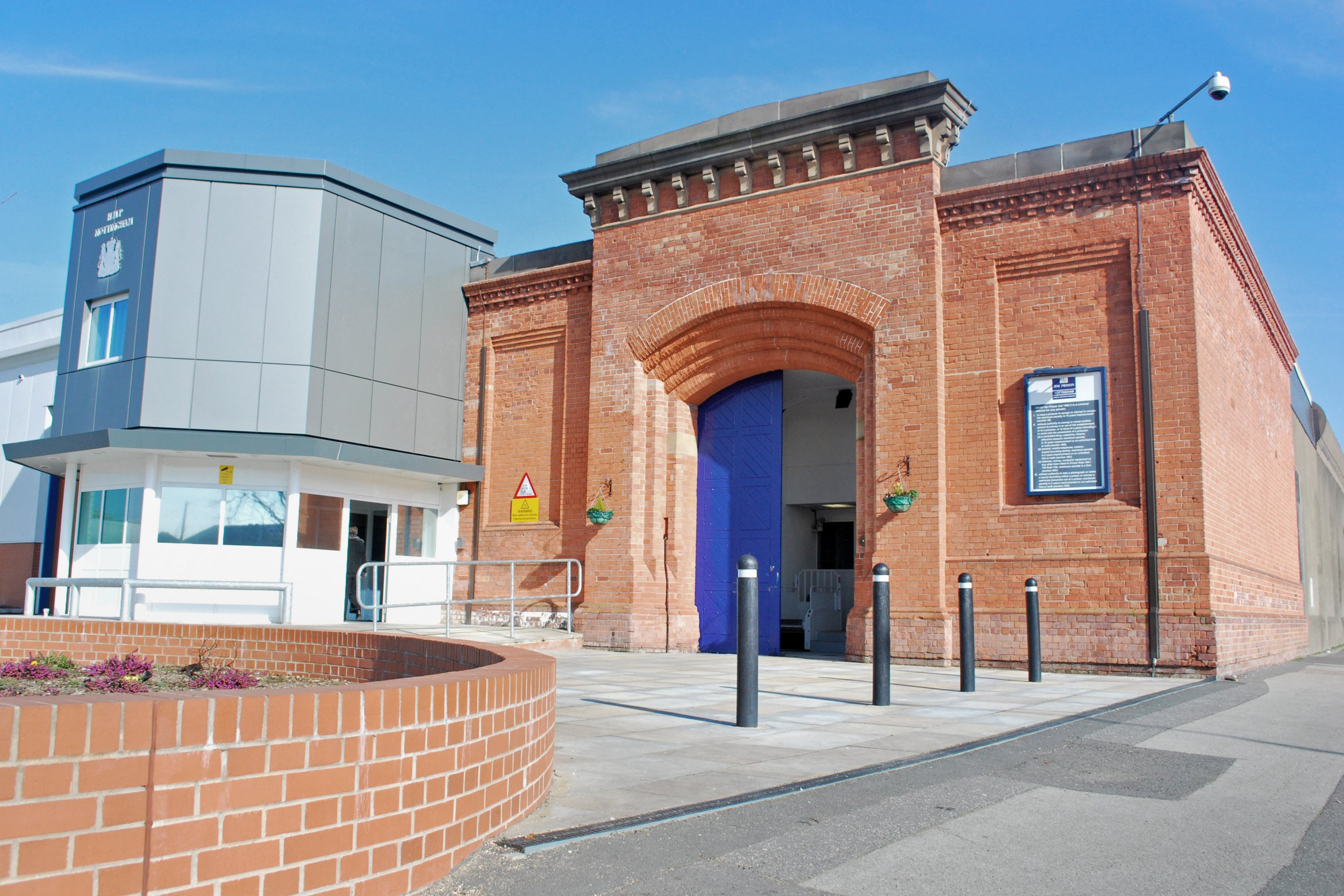 Inmate charged with GBH after cutting prison officer's throat with razor