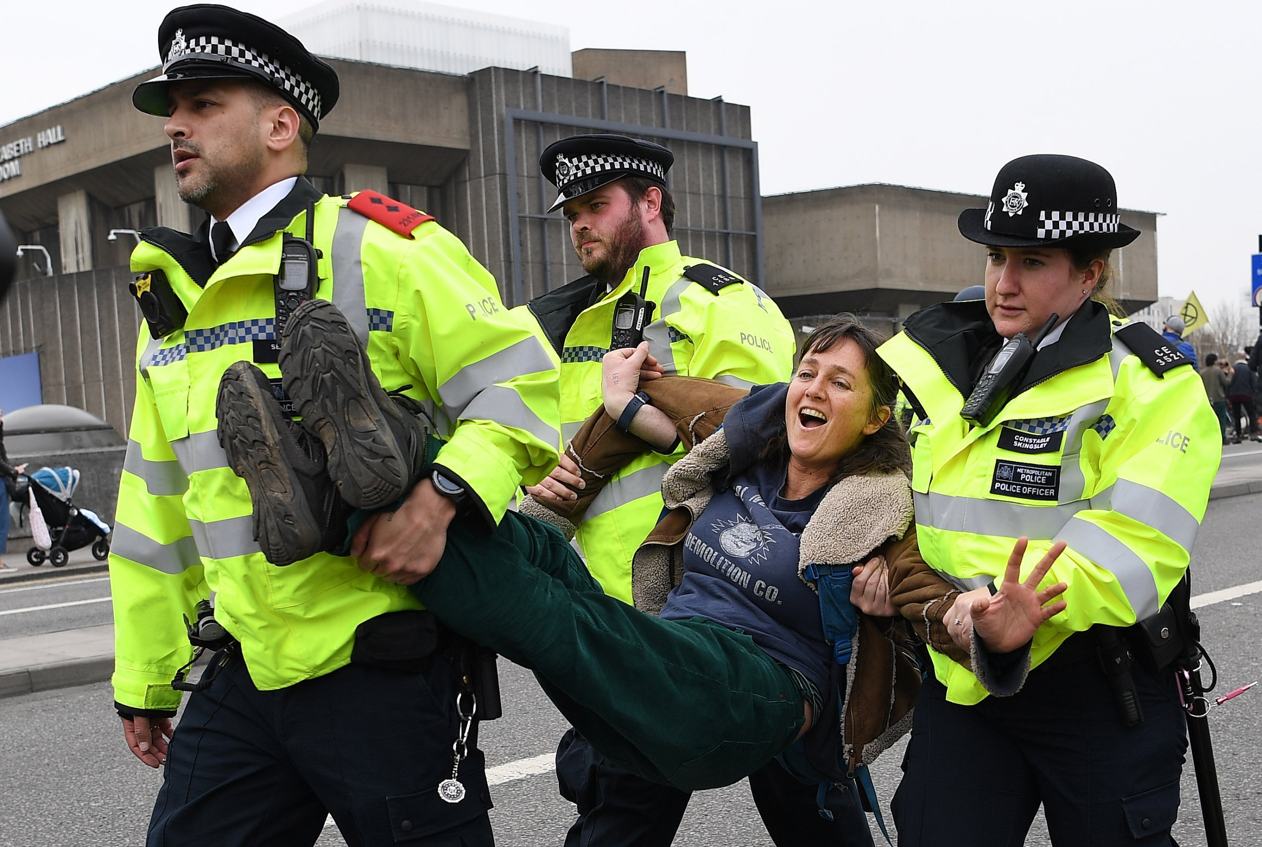 epa07510037 Police arrest a climate change protester on Waterloo Bridge during Earth Day climate change protests in London, Britain, 16 April 2019. Waterloo Bridge remains closed as protests continue. EPA/ANDY RAIN