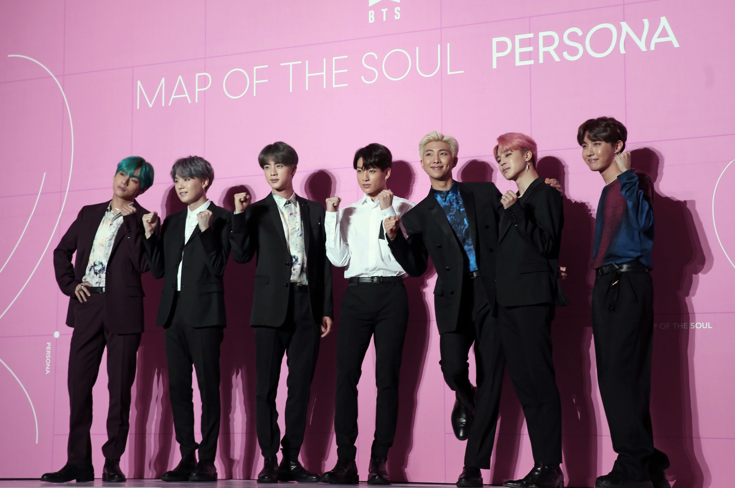 "Members of South Korean K-Pop group BTS pose for photos during a press conference to introduce their new album ""Map of the Soul: Persona"" in Seoul, South Korea, Wednesday, April 17, 2019. (Lee Jae-hee/Yonhap via AP)"