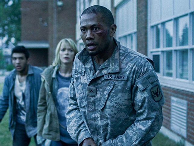 Scene from Black Summer which shows actors Jaime King, Justin Chu Cary and more